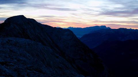 Timelapse of sunrise over mountain peaks. Sun raised above sharp peaks of Alps.  Footage