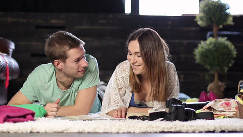 Young couple planning romantic adventure with map Footage
