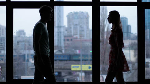 Silhouette of romantic couple embracing by window Stock Video Footage