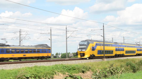 Two intercity trains of the Dutch Railways (NS) passing in opposite directions a Footage