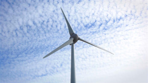 Wind turbine turning with clouds in the background Footage