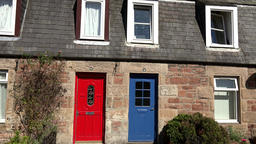Great Britain Scotland Highland Invergordon Joss Street colorful house entrances Footage