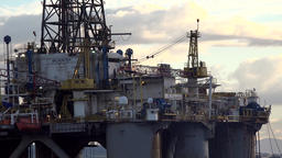 Great Britain Scotland Highland Invergordon close drive past oil platform Footage