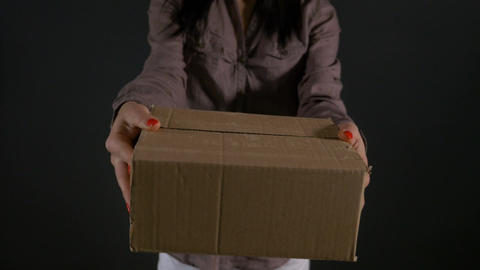 Woman hands holding and showing a cardboard box package in front of the camera Footage