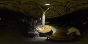 360 VR Family having meal in outdoor restaurant at night, Mauritius Footage