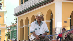 Cuba Tourism: Real People in Trinidad de Cuba, Senior Riding a Horse Drawn Carri
