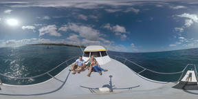360 VR Family traveling by yacht and looking at dolphins in the ocean Footage