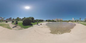 360 VR Pond with statue and walking people in Turia Gardens, Valencia Footage
