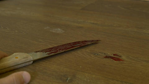 Bloody Knife in Man Hand Image