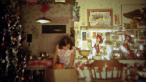 1965: Girl unboxes stuffed animal Christmas gag gift from zainy mother. SAN DIEG Footage