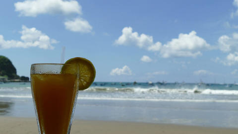Tropical drink with Pacific Ocean on background Footage