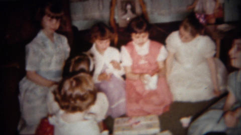 1962: Girlfriends in long dresses open birthday presents Footage