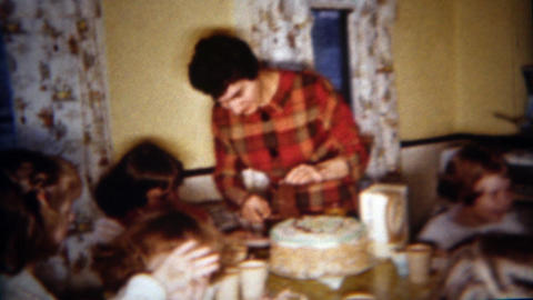 1962: Mother serving birthday cake little girls party Footage
