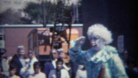 1964: Creepy clowns at parade salutes military heroes Footage