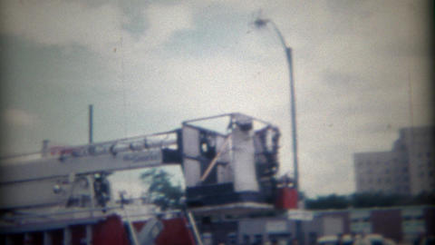 1964: Red fire department truck brigade parading through town Footage