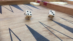 Backgammon luck cubes in slow motion Stock Video Footage