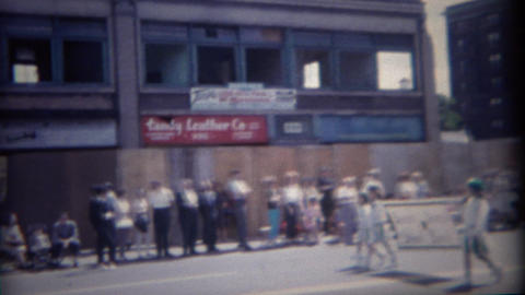 1962: American flag leading 4th of July parade green marching band Footage