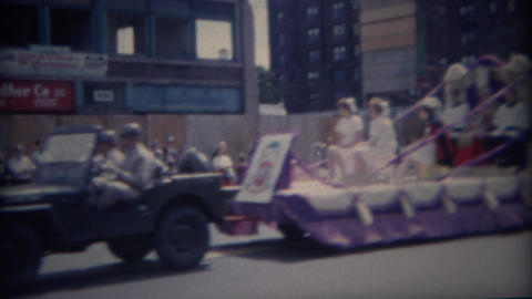 1962: Army jeep pulling parade float of religious church people Footage