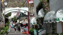 Spain Gran Canary Mogán 040 alley with arches and shops Footage