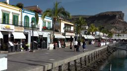 Spain Gran Canary Mogán 036 buildings at harborside promenade Footage