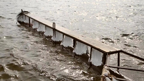 Icy pier on the river in the spring Footage