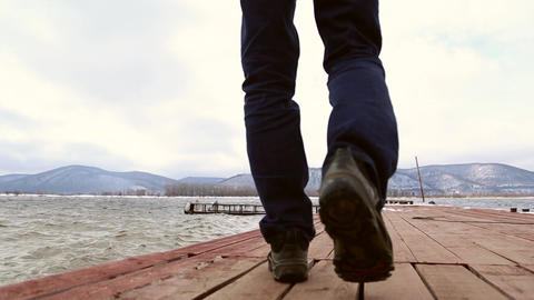 The man walks on the pier GIF