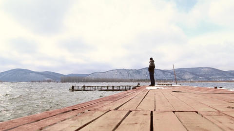 The man walks on the pier Footage