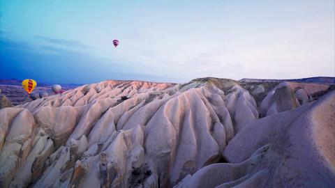 Hot air balloons flying in Cappadocia - Turkey - Aerial Shot