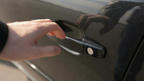 Close up human hand opening car door. Auto business, car sale, technology and pe Live Action