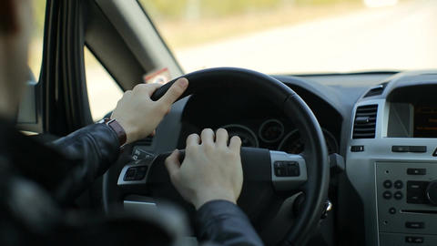 A man inside his car, driving on a summer day Footage