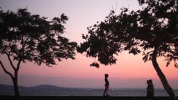 A Kid Walking On Coastal Street At Sunset 1 Footage