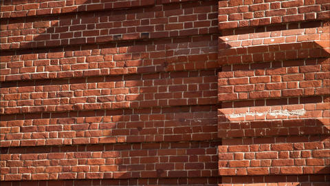 Timelapse Light Shadow Crawls Slowly on Old Red Brick Wall Footage