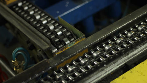 Closeup Metal Conveyor Belts Move Perpendicular Each Other Footage