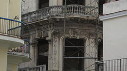 Zoom out from vintage building in reconstruction-Old Havana, Cuba Footage