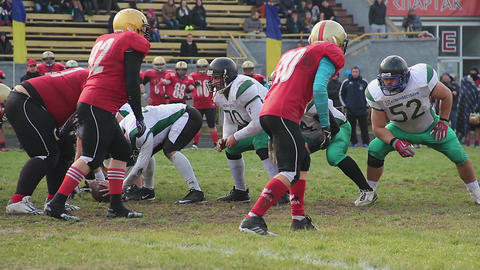 Strained attack on scrimmage line, winners celebrating success, gridiron match Live Action