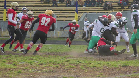 Football players attack, tackle rival carrying ball to end zone, masculine sport Footage