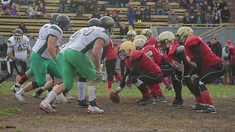 Blazing attack of offence team on defense ball carrier, american football match Footage