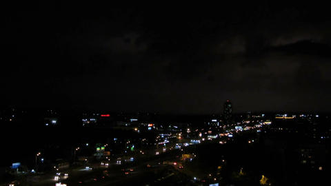 Lightning bolts strike in night sky, thunder clash sounds, rainstorm in the city Footage