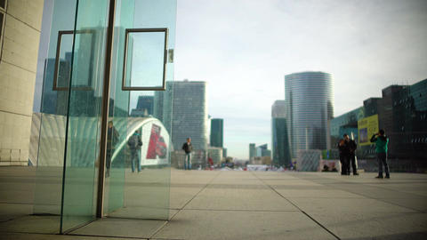 Urban life, tourists taking pictures, walking near all glass modern buildings Footage