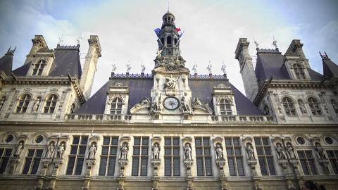 French and EU flags waving atop Hotel de Ville city administration in Paris Footage