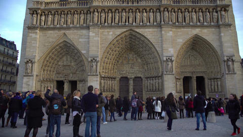 Tourists looking at ancient catholic cathedral Notre-Dame in Paris, sightseeing Footage