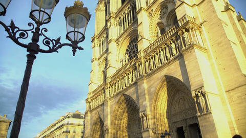 Notre-Dame cathedral in yellow sunlight, famous attraction on a sunny day Footage