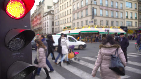 Time-lapse of hectic urban life, people crossing street, red light for cars Footage