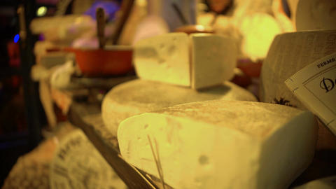 Various expensive cheeses lying on showcase at gourmet shop, food production ライブ動画