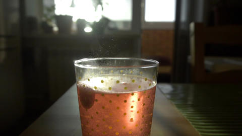 Dissolving Aspirin fizzy pill in glass of water Footage