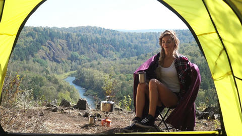 Blonde Woman Tourist Sitting On Camping Chair Footage
