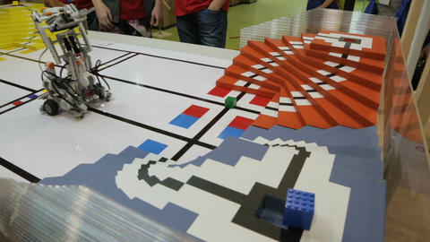 Mechanic Designed Toy Robot with Moving Parts Drives on Table Footage