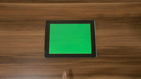 Man Hand Using Horizontal Digital Tablet with Green Swipe Right on the Backgroun Footage