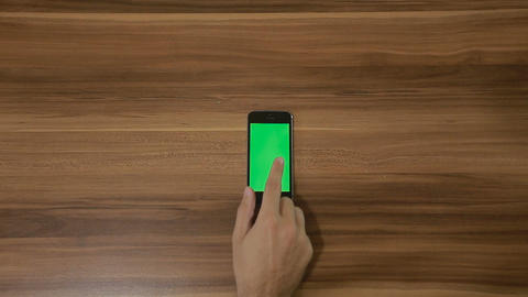 Smartphone Swipe left hand gesture on the Background of Wooden Table.Vertical Footage