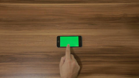 Smartphone Swipe Right hand gesture on the Background of Wooden Table.Horizontal Footage
